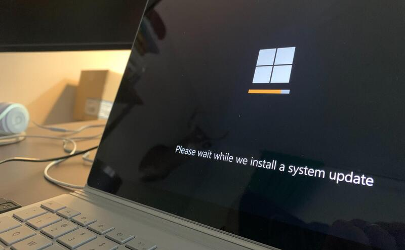 A laptop is running it's updates.